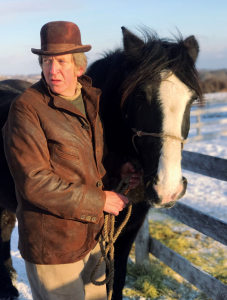 Thompson with Barney the horse in a paddock in winter