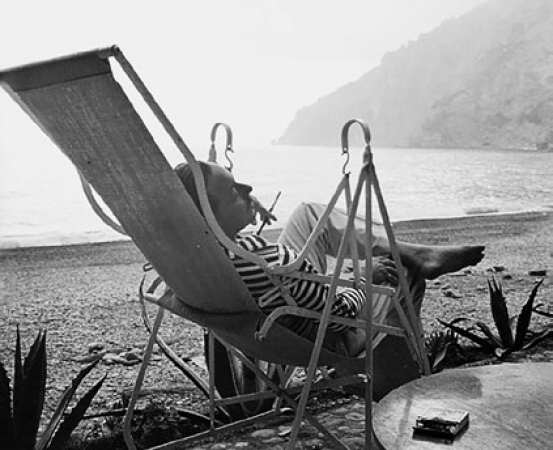 Tennessee Williams, American writer, Italy, 1956, by the sea, smoking, black and white